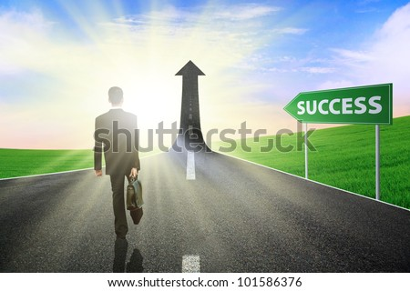 Businessman walking on the highway road going up as an arrow, symbolizing as the way to gain success
