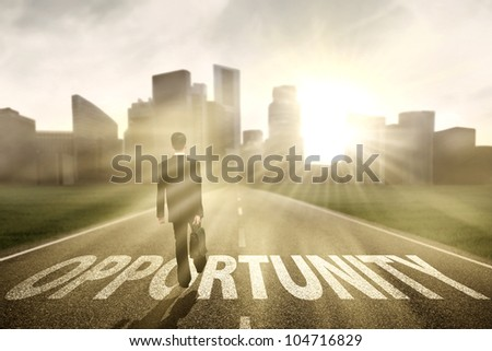 Businessman walking on the highway road to new city, symbolizing as the way to the new opportunity