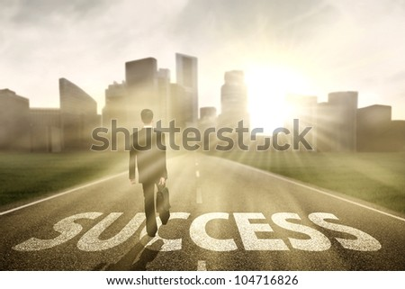 Businessman walking on the highway road to new city, symbolizing as the way to the new success