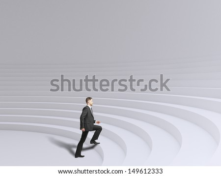 businessman walking up stadium stairs