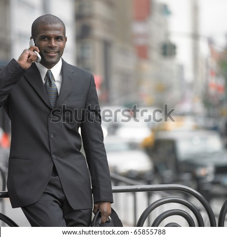 stock-photo-businessman-walking-while-talking-on-cell-phone-65855788.jpg