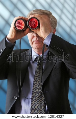 Businessman watching for new ways to develop profits