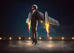 Businessman wear a rocket suit to lift , Business success concept .