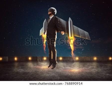 Photo of  Businessman wear a rocket suit to lift , Business success concept .