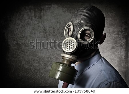 businessman wear gas mask grunge background - stock photo
