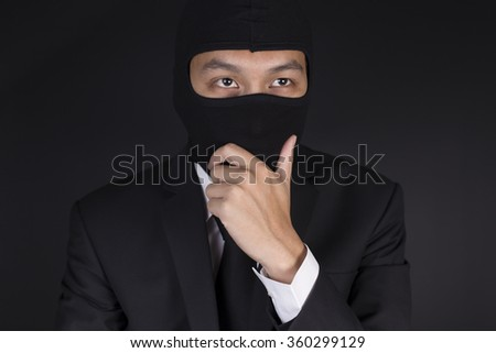 Businessman Wearing a Balaclava Thinking Corruption Plan #360299129