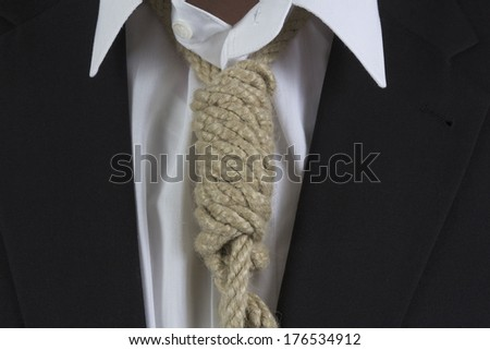 Businessman wearing a hangman's noose instead of a tie around the neck