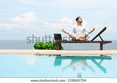 Businessman wearing a suit doing Yoga on the beach #528869704