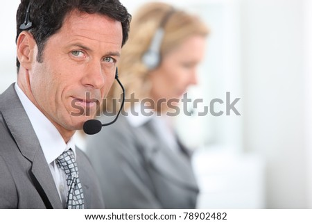 Businessman wearing a telephone headset