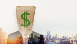 Businessman wearing crumpled brown paper bag, with green dollar sign, and double exposure cityscape in sunrise