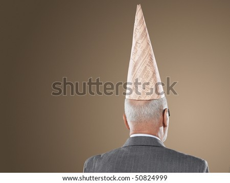 Businessman Wearing Dunce hat, back view, head and shoulders