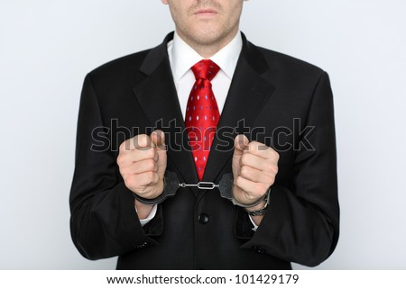 businessman wearing handcuffs