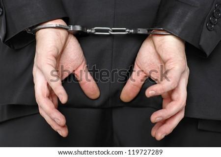 businessman wearing handcuffs