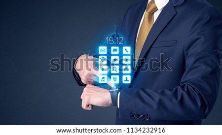 Businessman wearing smartwatch with application icons. #1134232916
