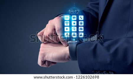 Businessman wearing smartwatch with application icons. #1226102698
