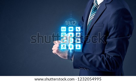 Businessman wearing smartwatch with application icons. #1232054995