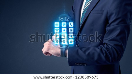 Businessman wearing smartwatch with application icons. #1238589673