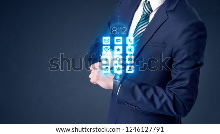 Businessman wearing smartwatch with application icons. #1246127791