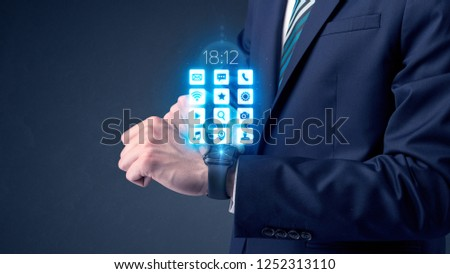 Businessman wearing smartwatch with application icons. #1252313110