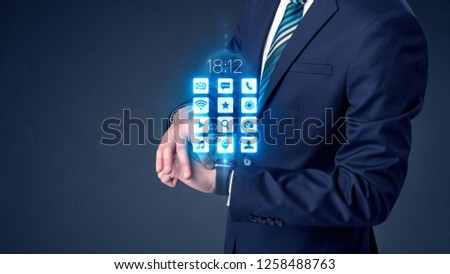 Businessman wearing smartwatch with application icons. #1258488763