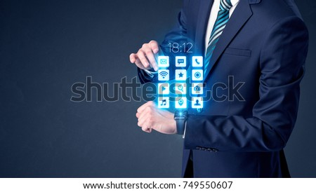 Businessman wearing smartwatch with application icons. #749550607