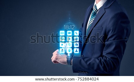 Businessman wearing smartwatch with application icons. #752884024
