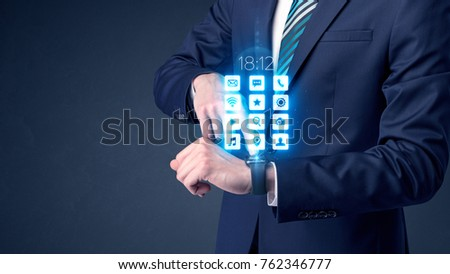 Businessman wearing smartwatch with application icons. #762346777