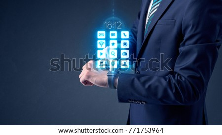 Businessman wearing smartwatch with application icons. #771753964