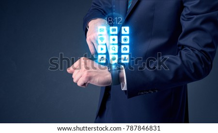 Businessman wearing smartwatch with application icons. #787846831
