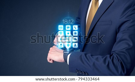 Businessman wearing smartwatch with application icons. #794333464
