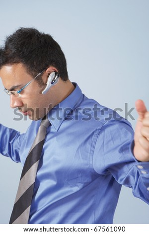 Businessman wearing sunglasses and a headset