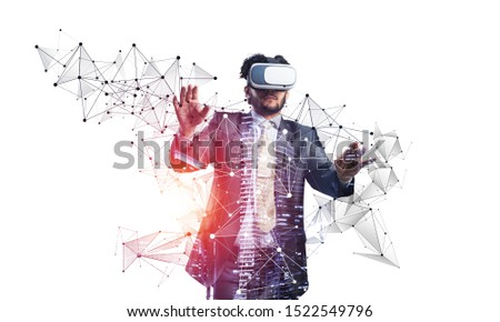 Businessman wearing VR headset working with virtual system. New reality modeling and design. Interacting with virtual interface. Mixed media with 3d objects. Business model simulation and management