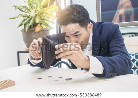 Businessman well-dressed with empty wallet-broke