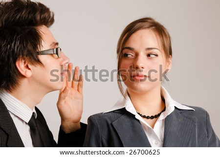 Businessman whispering to his partner