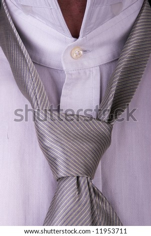 Businessman, white collar worker - closeup of a shirt and tie required in a business formalwear