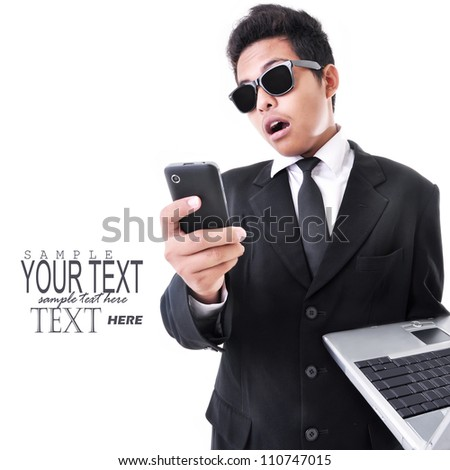 businessman who are shocked carry a cell phone and laptop, isolated on white background