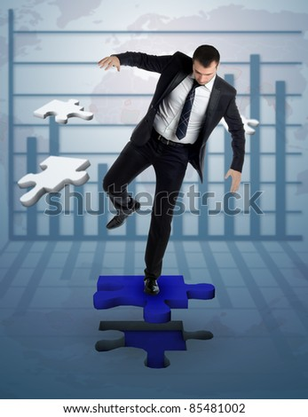 businessman who complete a puzzle on a background with statistics