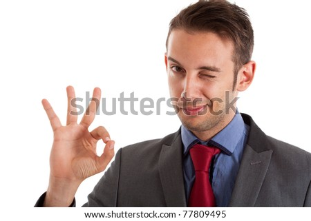 Businessman winking at you while doing the ok sign