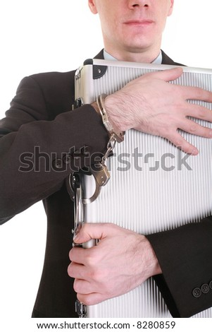 businessman with a briefcase and handcuffs - stock photo