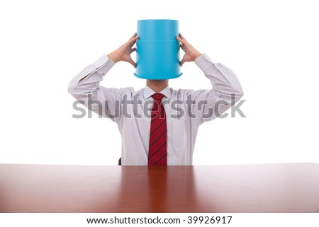 businessman with a bucket on his head