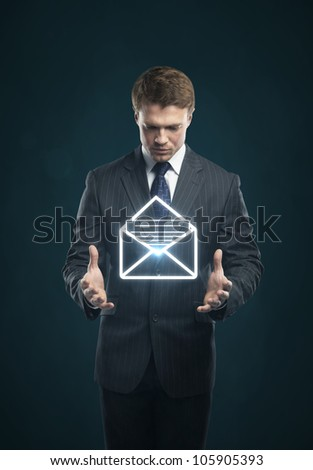 Businessman with a envelope on his hands