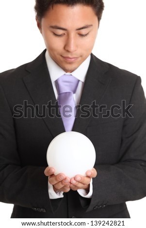 Businessman with a glass ball, looking in to the future. White background. #139242821