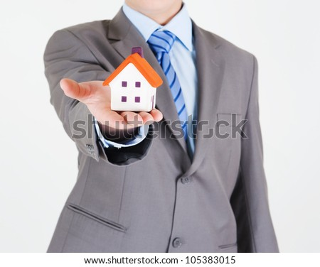 Businessman with a house in his hand