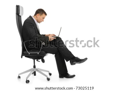 Businessman with a laptop sitting in a chair in a bright office. Isolated on white background