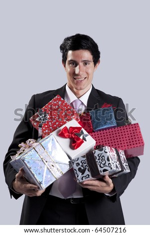 Businessman with a lot of gift packages (isolated on gray)