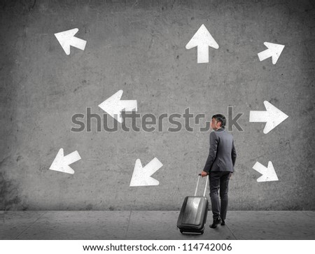 Businessman with a luggage does not know which way to go