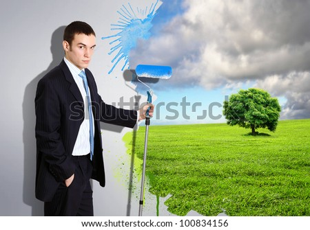 Businessman with a paint brush creating natural background