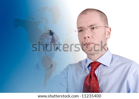 Businessman with a pen in front of a worldcard. Studio picture