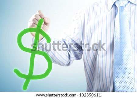 Businessman with a pen in hand drawing dollar sign. Concept for business minded