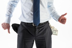 Businessman with a pocket full of money and an empty pocket showing thumbs up and down